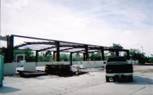 "140 mph exposure ""C"" structural steel frame"