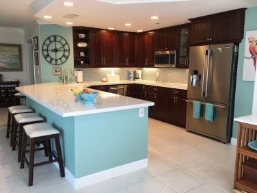 Spacious Kitchen with Cherry Cabinets and Quartz Countertop